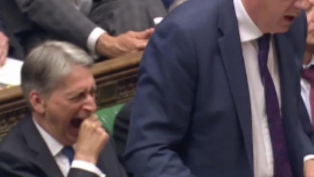 Philip Hammond yawning in Parliament during Prime Minister;s Questions