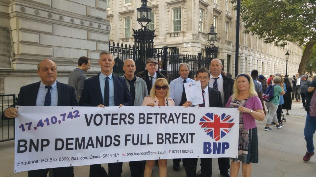 BNP activists paid a visit to Downing Street with a BNP Demands Full Brexit banner